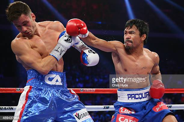 Manny Pacquiao of the Philippines and Chris Algieri of the United States exchange punches during the WBO world welterweight title at The Venetian on...