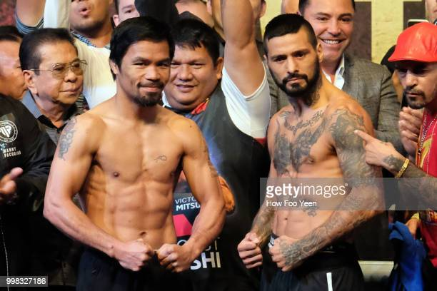 Manny Pacquiao of the Philippines and Lucas Matthysse of Argentina pose during weighin for their fight July 14 2018 in Kuala Lumpur Malaysia