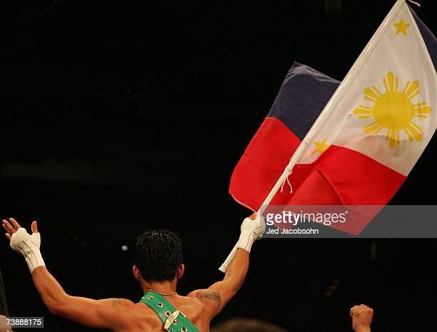 Manny Pacquiao of the Philippines celebrates after defeating Jorge Solis of Mexico during the WBC International Featherweight Championship April 14,...