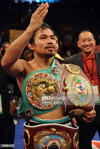 Manny Pacquiao of the Philippines celebrates after defeating Miguel Cotto of Puerto Rico during their WBO welterweight title fight on November 14...