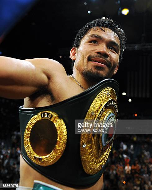 Manny Pacquiao of the Philippines celebrates after defeating Ricky Hatton of England in the second round of their Junior Welterweight title fight at...