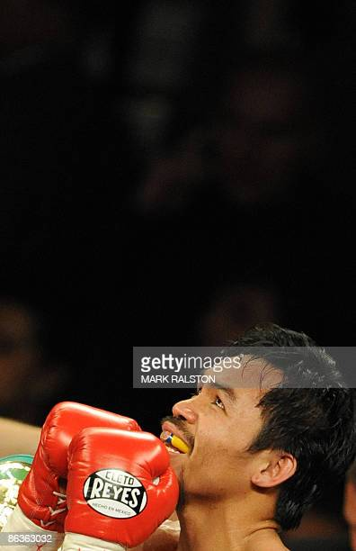 Manny Pacquiao of the Philippines celebrates after defeating Ricky Hatton of England in their Welterweight title fight at the MGM Grand Garden Arena...