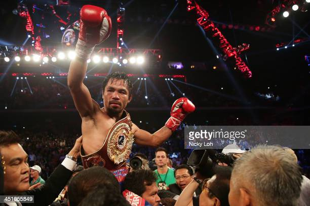Manny Pacquiao of the Philippines celebrates winning against Brandon Rios of the US during their 'Clash in Cotai' WBO International Welterweight...