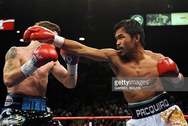 Manny Pacquiao of the Philippines connects a punch on Ricky Hatton of England during their Junior Welterweight title fight at the MGM Grand Garden...