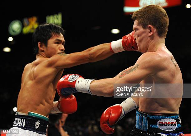 Manny Pacquiao of the Philippines connects a punch on the face of Ricky Hatton of England during their Junior Welterweight title fight at the MGM...