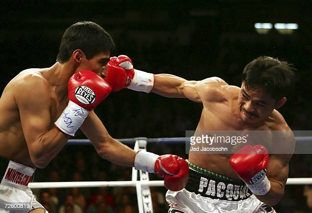 Manny Pacquiao of the Philippines connects with a right to the face of Erik Morales of Mexico during their super featherweight bout at the Thomas...