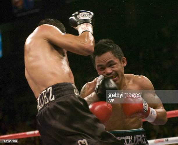 Manny Pacquiao of the Philippines defends against Juan Manuel Marquez of Mexico during their World Boxing Council super featherweight championship...