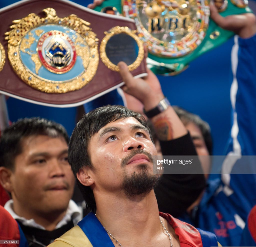 Manny Pacquiao of the Philippines enters the arena for his World Boxing Organization (WBO) welterweight title fight against Joshua Clottey of Ghana at Cowboys Stadium in Dallas, Texas on March 13, 2010. Filipino superstar Pacquiao easily defeated Clottey by unanimous 12-round decision to retain his WBO welterweight title. AFP PHOTO/Chris Cozzone