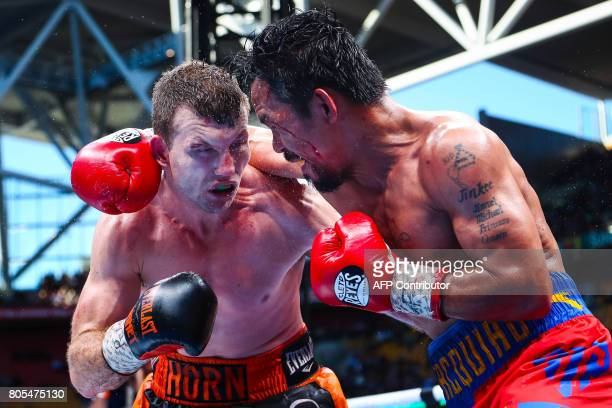 TOPSHOT CORRECTION Manny Pacquiao of the Philippines fight Jeff Horn of Australia during the World Boxing Organization boat at Suncorp Stadium in...