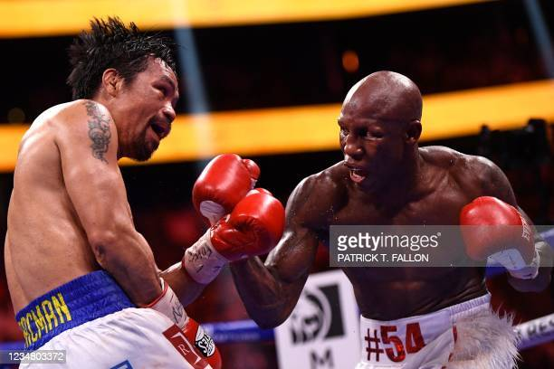 Manny Pacquiao of the Philippines fights against Yordenis Ugas of Cuba during the WBA Welterweight Championship boxing match at T-Mobile Arena in Las...