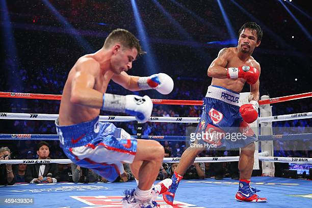 Manny Pacquiao of the Philippines knockes down Chris Algieri of the United States during the world welterweight title at The Venetian on November 23...