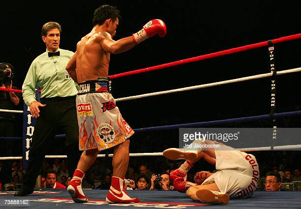 Manny Pacquiao of the Philippines knocks down Jorge Solis of Mexico during the WBC International Featherweight Championship April 14, 2007 at the...