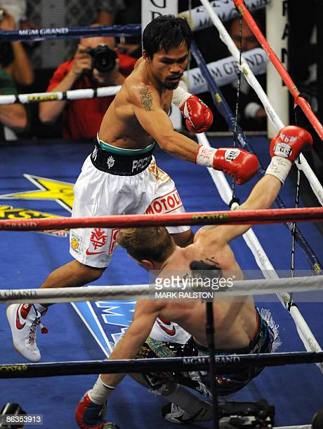 Manny Pacquiao of the Philippines knocks out Ricky Hatton of England before winning their Welterweight title fight at the MGM Grand Garden Arena on...
