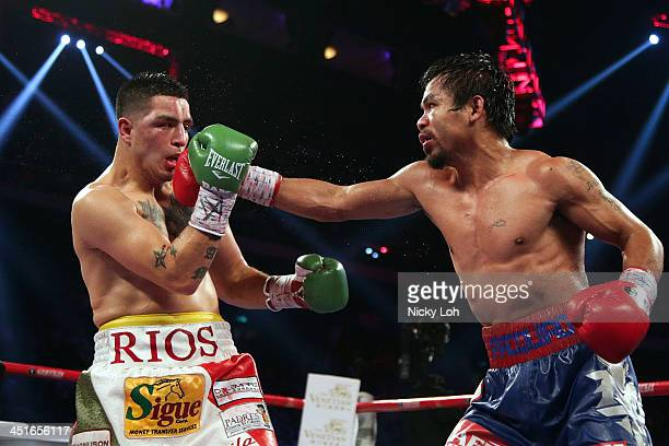 Manny Pacquiao of the Philippines punches Brandon Rios of the U.S. During their 'Clash in Cotai' WBO International Welterweight title fight on...