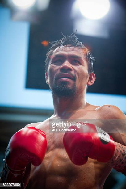 Manny Pacquiao of the Philippines reacts after his defeat to Jeff Horn of Australia in their World Boxing Organisation welterweight boxing match at...
