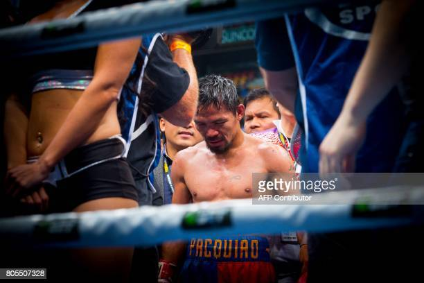 TOPSHOT Manny Pacquiao of the Philippines reacts to fans following his defeat to Jeff Horn of Australia in their World Boxing Organisation...