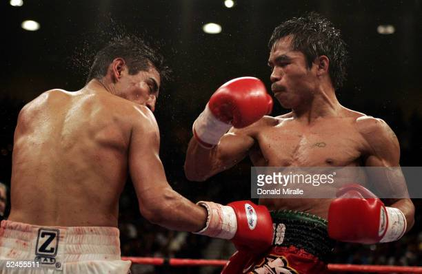 Manny Pacquiao of the Philippines throws a right hook at Erik Morales of Mexico during Morales' 1513 unanimous decision win over Pacquiao during the...