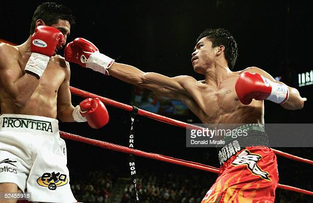 Manny Pacquiao of the Phillipines swings at Erik Morales of Mexico during Morales' 1513 unanimous decision win over Pacquiao during their World Super...