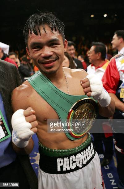 Manny Pacquiao of the Phillippines celebrates after knocking out Erik Morales of Mexico in the 10th round during their Super Featherweight...