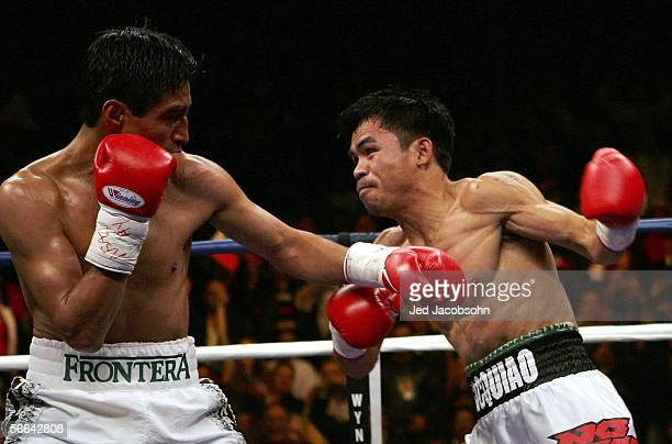 Manny Pacquiao of the Phillippines looks to throw a left at Erik Morales of Mexico during their Super Featherweight Championship fight at Thomas Mack...