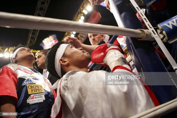 Manny Pacquiao of the Phillippines looks up before his fight against Erik Morales of Mexico in the Super Featherweight Championship fight at Thomas...