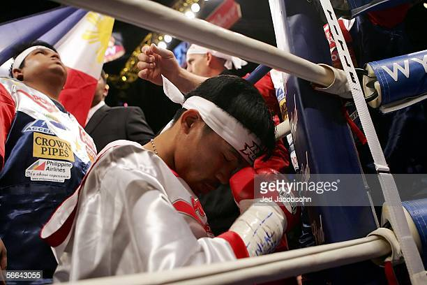 Manny Pacquiao of the Phillippines prays before his fight against Erik Morales of Mexico in the Super Featherweight Championship fight at Thomas Mack...
