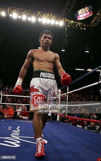 Manny Pacquiao of the Phillippines walks back to his corner during the Super Featherweight Championship fight against Erik Morales of Mexico at...