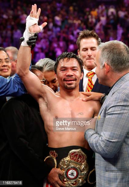 Manny Pacquiao poses after defeating Keith Thurman by split decision in a WBA welterweight title fight at MGM Grand Garden Arena on July 20 2019 in...