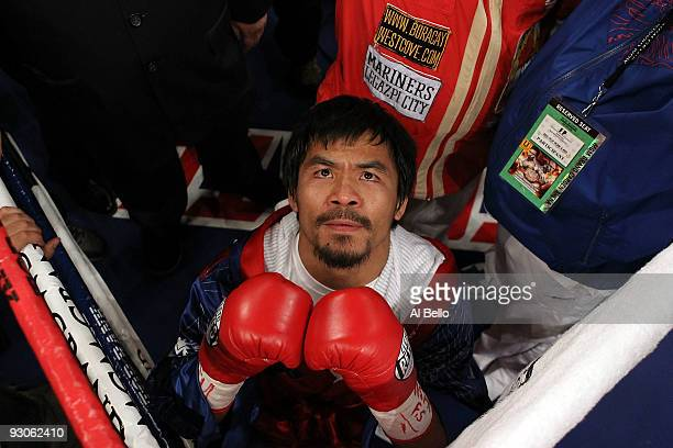 Manny Pacquiao prays in the ring before taking on Miguel Cotto during their WBO welterweight title fight at the MGM Grand Garden Arena on November 14...