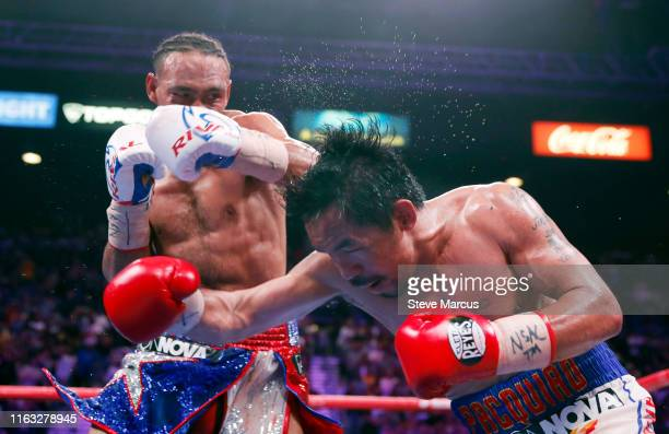 Manny Pacquiao takes a punch from Keith Thurman during their WBA welterweight title fight at the MGM Grand Garden Arena on July 20 2019 in Las Vegas...