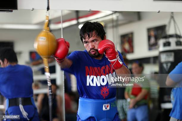 Manny Pacquiao takes part in a training session on March 4 2014 in General Santos Philippines Pacquiao will fight for WBO welterweight championship...