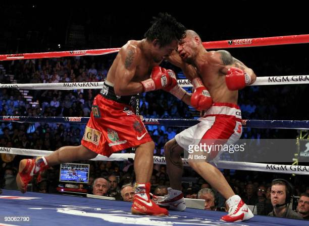 Manny Pacquiao throws a left at Miguel Cotto during their WBO welterweight title fight at the MGM Grand Garden Arena on November 14 2009 in Las Vegas...