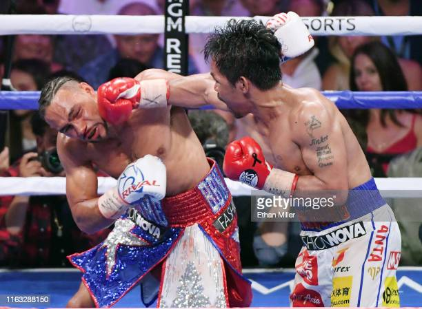 Manny Pacquiao throws a right at Keith Thurman in the eighth round of their WBA welterweight title fight at MGM Grand Garden Arena on July 20 2019 in...