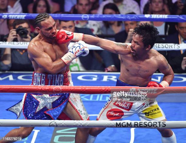 Manny Pacquiao throws a right at Keith Thurman in the sixth round of their WBA welterweight title fight at MGM Grand Garden Arena on July 20 2019 in...