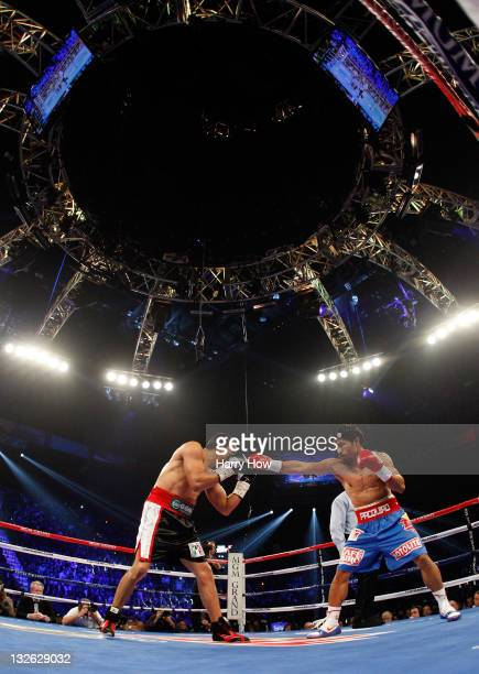 Manny Pacquiao throws a right punch at Juan Manuel Marquez during the WBO world welterweight title fight at the MGM Grand Garden Arena on November 12...