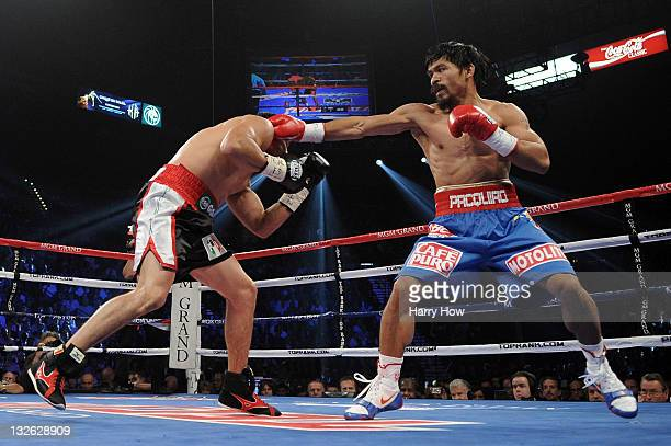 Manny Pacquiao throws a right to the body of Juan Manuel Marquez during the WBO world welterweight title fight at the MGM Grand Garden Arena on...