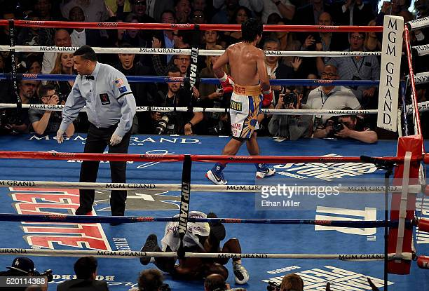 Manny Pacquiao walks to his corner after knocking down Timothy Bradley Jr during their welterweight championship fight on April 9 2016 at MGM Grand...