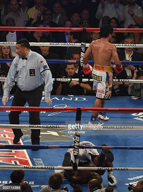Manny Pacquiao walks to his corner after knocking down Timothy Bradley Jr. During their welterweight championship fight on April 9, 2016 at MGM Grand...