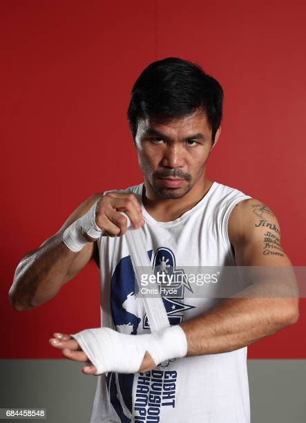 Manny Pacquiao warps his hands before a training session at the Elorde boxing Gym on May 19 2017 in Manila Philippines