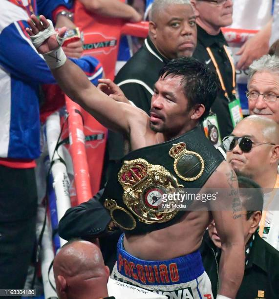 LAS VEGAS NEVADA JULY 20 Manny Pacquiao waves to his fans after going 12 rounds with Keith Thurman during their fight for the WBA welterweight title...