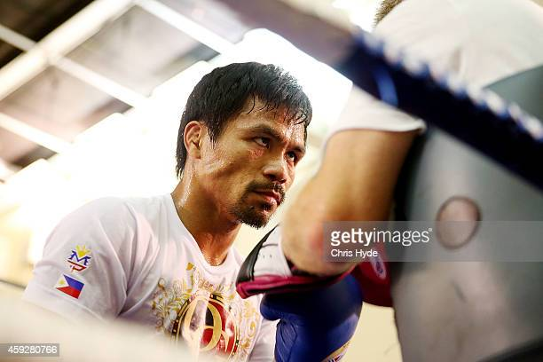 Manny Pacquiao works the mitts with trainer Freddie Roach during a workout session at The Venetian on November 20 2014 in Macau Macau