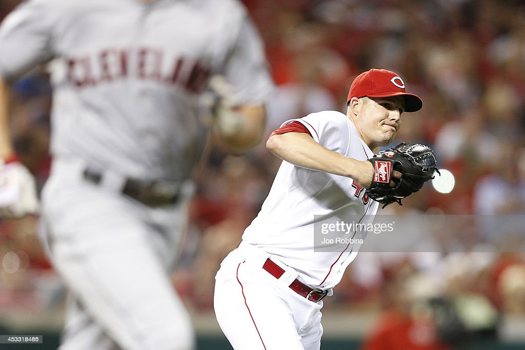 Manny Parra #43 of the Cincinnati Reds makes a play to first after fielding a bunt in the eighth inning of the game against the Cleveland Indians at Great American Ball Park on August 7, 2014 in Cincinnati, Ohio. The Reds won 4-0.
