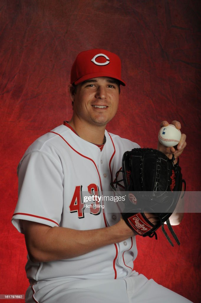 Manny Parra #43 of the Cincinnati Reds poses during MLB photo day on February 16, 2013 at the Goodyear Ballpark in Goodyear, Arizona.