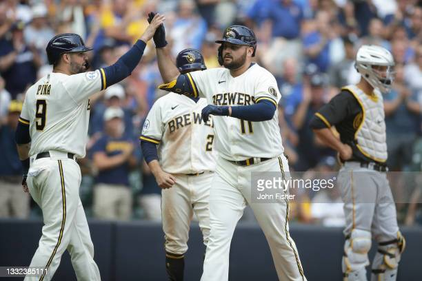 Manny Pina congratulates Rowdy Tellez of the Milwaukee Brewers after his three run homer in the seventh inning against the Pittsburgh Pirates at...