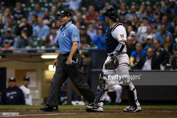 Manny Pina of the Milwaukee Brewers argues a call with umpire Angel Hernandez in the ninth inning Arizona Diamondbacks at Miller Park on May 22 2018...