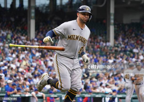 Manny Pina of the Milwaukee Brewers hits a grand slam during the fifth inning of a game against the Chicago Cubs at Wrigley Field on August 12, 2021...