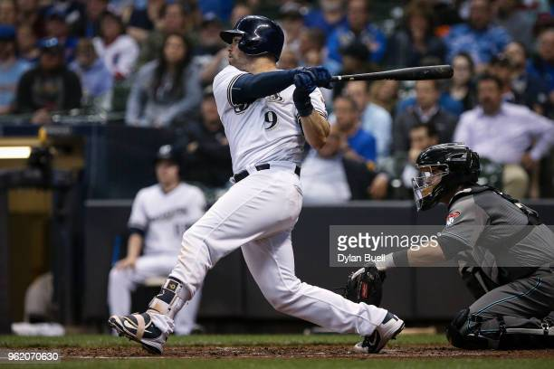 Manny Pina of the Milwaukee Brewers hits a single in the fifth inning against the Arizona Diamondbacks at Miller Park on May 22 2018 in Milwaukee...