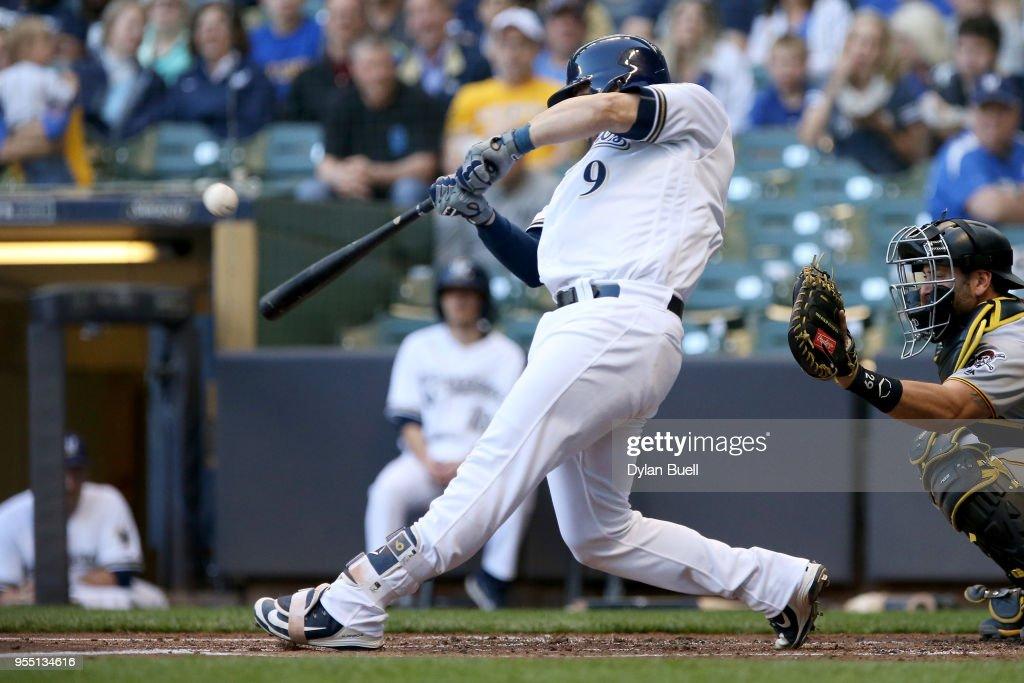 Manny Pina #9 of the Milwaukee Brewers hits a single in the second inning against the Pittsburgh Pirates at Miller Park on May 5, 2018 in Milwaukee, Wisconsin.