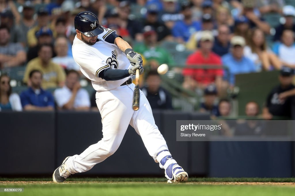 Manny Pina #9 of the Milwaukee Brewers hits a two run home run during the eighth inning of a game against the Pittsburgh Pirates at Miller Park on August 16, 2017 in Milwaukee, Wisconsin.