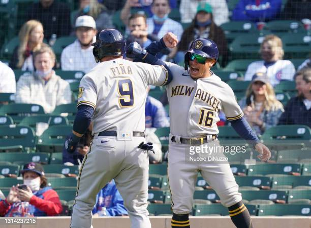 Manny Pina of the Milwaukee Brewers is congratulated by Kolten Wong following his two run home run during the seventh inning of a game against the...